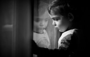 child-kid-baby-toddler-boy-girl-reflection-sad-depressed-dim-window-looking-watching-waiting-814x518